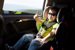 child in 5 point harness seat