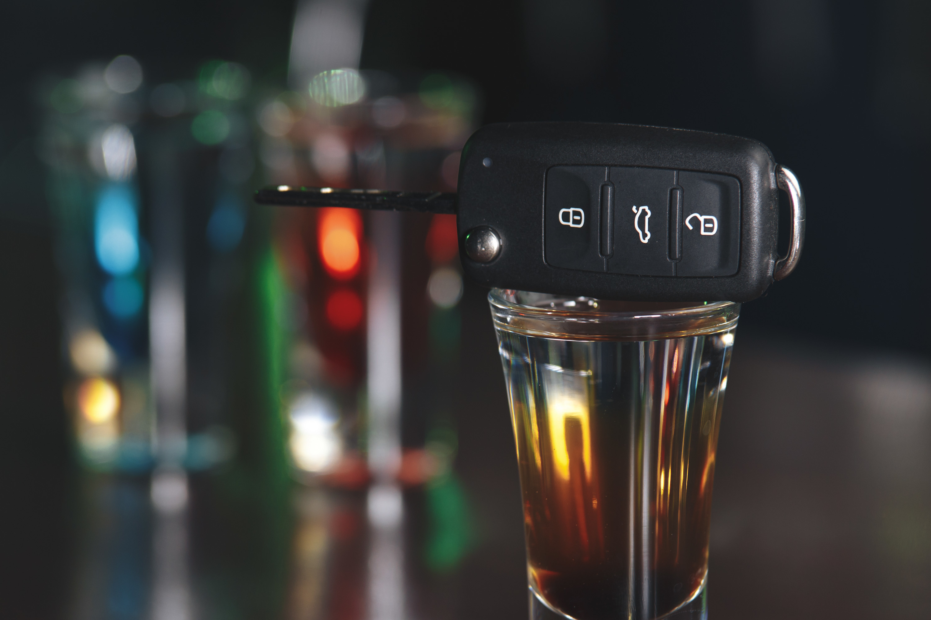 Stock image of key fob and alcohol on table